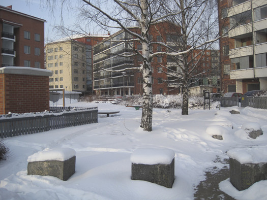 <p>The park behind our school building is located in middle of apartment buildings. At this moment it is covered with snow.</p>